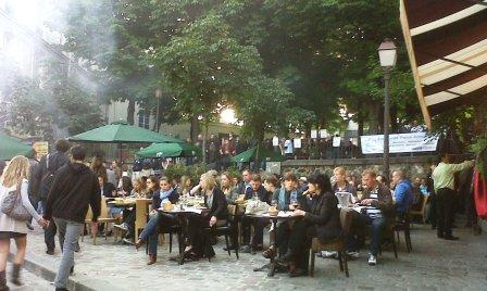 """Sitting in an open air cafe in Montmartre"""