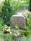 """Alongside a hiking trail is a tombstone marking the spot where battered body of Angelique Dumetz was found in Compiegne"""