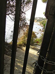 """Padlocked gate preventing continuation to the hiking trail in the Sentier Littoral"""