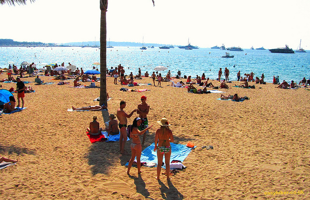 """Full beach in Cannes where a salad nicoise is expensive"""