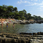 """A portion of the beach along the Ile de Lerins in Cannes France"""
