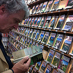 """Easy Hiker reviewing a hiking guide book"""