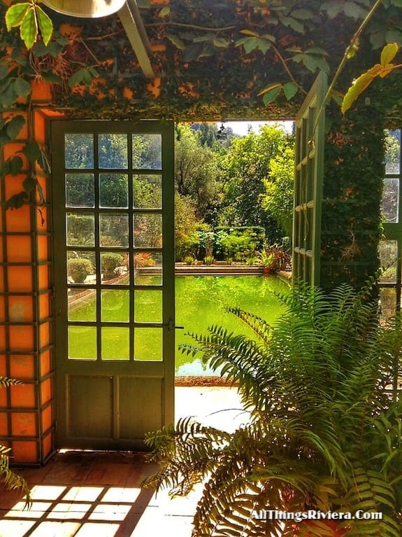 """looking out from the green house in the Serre de La Madone Garden"""