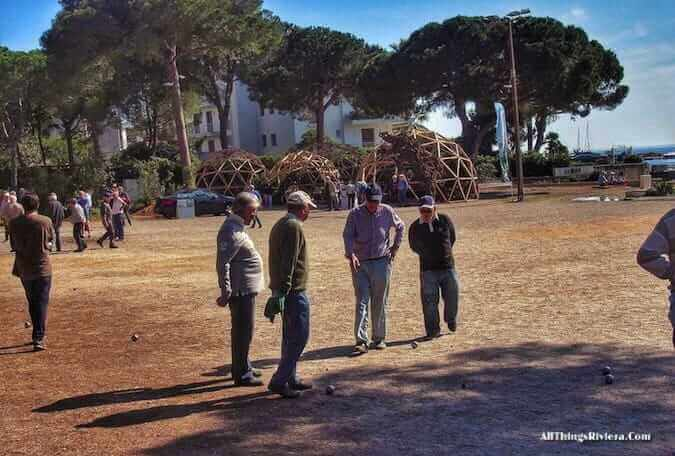 """petanque players in Juan les Pins in front of a garden for the inaugural Festival des Jardins"""