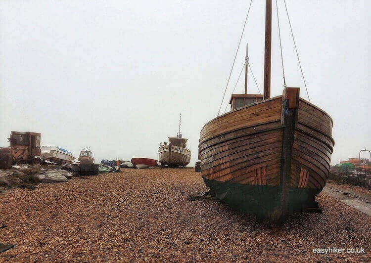 """the fishermen of Hastings and their docked boats"""
